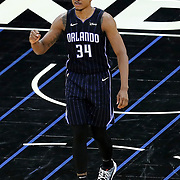 ORLANDO, FL - APRIL 07: Wendell Carter Jr. #34 of the Orlando Magic pumps his fist after a score against the Washington Wizards during the first half at Amway Center on April 7, 2021 in Orlando, Florida. NOTE TO USER: User expressly acknowledges and agrees that, by downloading and or using this photograph, User is consenting to the terms and conditions of the Getty Images License Agreement. (Photo by Alex Menendez/Getty Images)*** Local Caption *** Wendell Carter Jr.