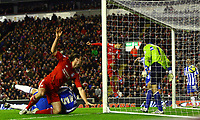 Football - FA Cup Fifth Round - Liverpool vs. Brighton and Hove Albion<br /> Luis Suarez of Liverpool heads the ball into the back of the net at Anfield