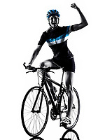 one caucasian cyclist woman cycling riding bicycle in silhouette isolated on white background