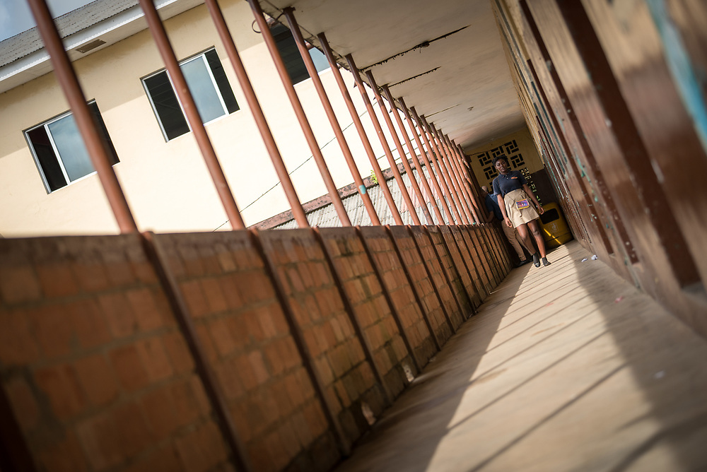 4 November 2019, Vriginia, Liberia: A student walks to class at Ricks Institute. The Liberia Baptist Convention runs Ricks Institute, a day and boarding school for currently 496 students from kindergarten up through 12th grade.