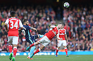 Shkodran Mustafi of Arsenal © heads the ball.. Premier league match, Arsenal v Middlesbrough at the Emirates Stadium in London on Saturday 22nd October 2016.<br /> pic by John Patrick Fletcher, Andrew Orchard sports photography.