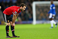 Juan Mata of Manchester United pulls his socks up.  Premier league match, Everton v Manchester Utd at Goodison Park in Liverpool, Merseyside on New Years Day, Monday 1st January 2018.<br /> pic by Chris Stading, Andrew Orchard sports photography.