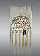 Medieval ivory comb with a central relief panel depicting David defeating a Lion. Third quarter of the 9th cent. AD from Metz. Inv. OA 354, The Louvre Museum, Paris. .<br /> <br /> If you prefer you can also buy from our ALAMY PHOTO LIBRARY  Collection visit : https://www.alamy.com/portfolio/paul-williams-funkystock/romanesque-art-antiquities.html . Type -   Louvre   - into the LOWER SEARCH WITHIN GALLERY box. Refine search by adding background colour, place, museum etc<br /> <br />  Visit our MEDIEVAL PHOTO COLLECTIONS for more   photos  to download or buy as prints https://funkystock.photoshelter.com/gallery-collection/Medieval-Romanesque-Art-Antiquities-Historic-Sites-Pictures-Images-of/C0000uYGQT94tY_Y