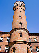 The Raudone Castle, which is now a school; Raudone, Lithuania Low-angle view of the main tower.