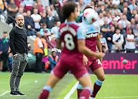 Football - 2019 / 2020 Premier League - West Ham United vs. Manchester City<br /> <br /> A glum looking Pep Guardiola, Manager of Manchester City, looks on as West Ham dominate possession at the London Stadium<br /> <br /> COLORSPORT/DANIEL BEARHAM