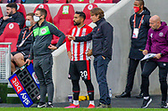 Brentford manager Thomas Frank gives tactical advice to Brentford midfielder Saman Ghoddos (20) during the EFL Sky Bet Championship match between Brentford and Coventry City at Brentford Community Stadium, Brentford, England on 17 October 2020.