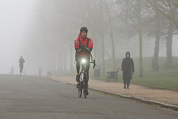 © Licensed to London News Pictures. 03/03/2021. London, UK. A cyclist in Finsbury Park, north London on a foggy morning. The Met Office has issued a yellow weather warning for fog in some parts of south east England with low visibility. Photo credit: Dinendra Haria/LNP