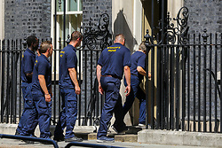 © Licensed to London News Pictures. 25/07/2019. London, UK. Staff from the Bishop's Move enter No 10 Downing Street to collect Theresa May's belongings. Photo credit: Dinendra Haria/LNP