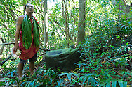 Greg Solatorio following ancient protocol for entrance into the Halawa Valley on the east end of the island of Molokai, Hawaii, USA