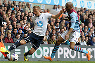 Tottenham Hotspur's Harry Kane competing with Aston Villa's Fabian Delph.  Barclays premier league match ,Tottenham Hotspur v Aston Villa at White Hart Lane in Tottenham, London  on Sunday 11th May 2014.<br /> pic by John Patrick Fletcher, Andrew Orchard sports photography.
