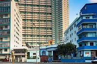 Two figures seem small in comparison to the Edificio Focsa in the Vedado area of Havana.