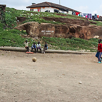 Now he champions proper waste disposal in Mathare through community service and making use of this field that was formerly a dumping ground, to coach girls and boys in football and other sports.