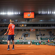 PARIS, FRANCE October 07. A ball boy offers a ball to Novak Djokovic of Serbia during his match against Pablo Carreno Busta of Spain in the Quarter Finals of the singles competition on Court Philippe-Chatrier during the French Open Tennis Tournament at Roland Garros on October 7th 2020 in Paris, France. (Photo by Tim Clayton/Corbis via Getty Images)