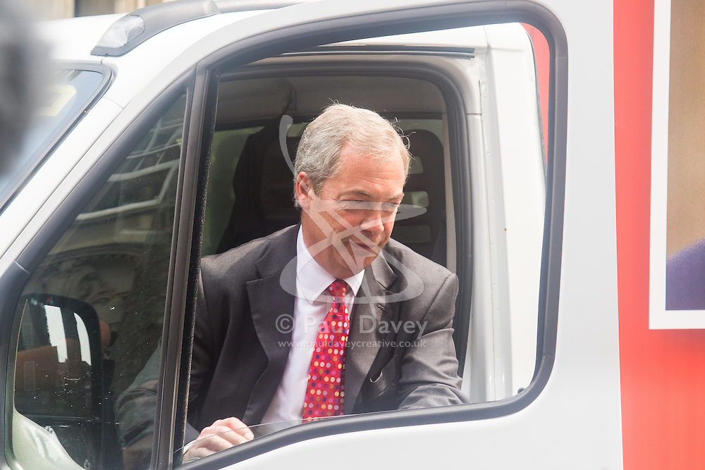 Smith Square, Westminster, London, June 7th 2016. UKIP Leader Nigel Farage launches a new campaign poster today outside Europe House ahead of a scheduled ITV Debate with the Prime Minister David Cameron. PICTURED: Farage arrives in the van carrying the poster.