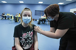 """© Licensed to London News Pictures. 03/07/2021. Sheffield, UK. Devon Pursall-Deverill,19,receives the first dose of the Pfizer/BioNTech vaccine at a pop-up vaccination clinic at Hillsborough Stadium in Sheffield as part of the """"Grab a jab"""" campaign. Photo credit: Ioannis Alexopoulos/LNP"""