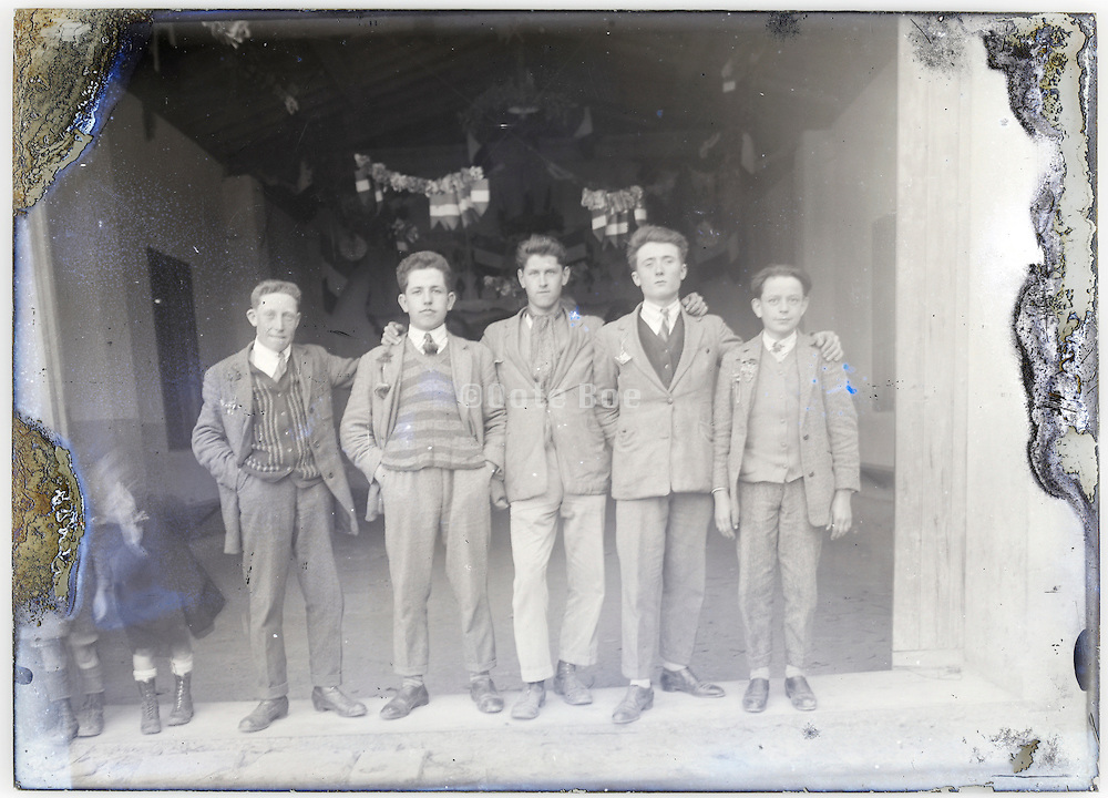 young adult village boys proudly posing on eroding glass plate