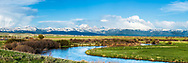Teton Valley Panorama.  The beautiful Teton Valley Idaho lies at the base of the majestic Grand Teton Mountain Range of eastern Idaho.  The Teton River winds through the bottom of it.<br /> <br /> This is a large file that can be printed 3.5 feet tall by 8-foot long at 182dpi.  Order panoramas directly from me for that custom touch.