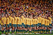 Players of the Wallabies lock arms for the national anthem during the First Test match between the Australian Wallabies and the British & Irish Lions at Suncorp Stadium on June 22, 2013 in Brisbane, Australia.
