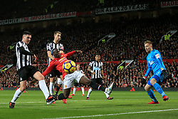 18th November 2017 - Premier League - Manchester United v Newcastle United - Romelu Lukaku of Man Utd shoots wide of the near post under pressure from Ciaran Clark of Newcastle - Photo: Simon Stacpoole / Offside.