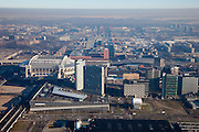 Nederland, Amsterdam, Zuidoost, 10-01-2009; omgeving station Bijlmer en Arena gebied; met woonmall ArenA met rechts Living Tomorrow (Huis en Kantoor van de Toekomst), links het Ajax stadion de Arena, kantoren; op het tweede plan het NS station en winkelcentrum Amsterdamsepoort, daarachter de Bijlmermeer; winterlandschap met inversie in de lucht; Bijlmer Arena Station and surrounding area, with shopping mall ArenA and to the right Living Tomorrow (House and Office of the Future), left the Ajax stadion Arena, surrounden by offices; on the second plan the railway station and shopping Amsterdamse Poort,at the horizon Bijlmermeer; winter-landscape with inversion in air;. .luchtfoto (toeslag); aerial photo (additional fee required); .foto Siebe Swart / photo Siebe Swart