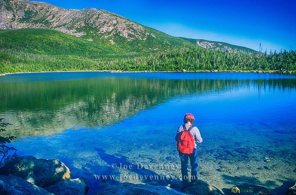 Hiker by a pond on Mount Katahdin. Maine