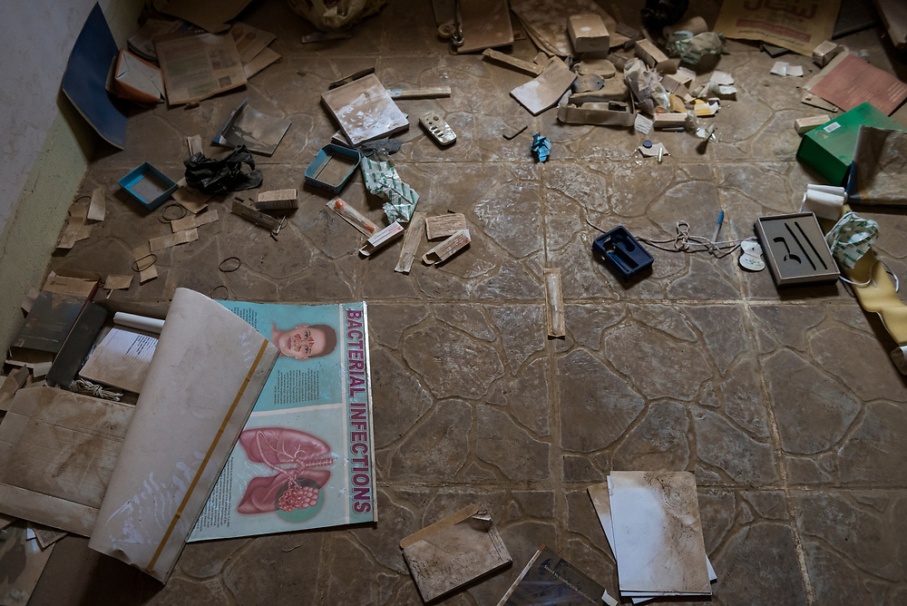 On October 19, 2016, ISIS was pushed out of the predominately Christian town of Qaraqosh, ending its destructive two-year occupation. Residents returned to find many of their homes and businesses, like this clinic, looted, damaged, or destroyed. (May 5, 2017)