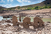 Derelict buildings submerged by flooding when a dam created a reservoir Embalse de Mansilla at Mansilla de la Sierra in La Rioja, Spain