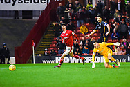 Kieffer Moore of Barnsley (19) gets round Richard O'Donnell of Bradford City (1) but the ball runs away from him during the EFL Sky Bet League 1 match between Barnsley and Bradford City at Oakwell, Barnsley, England on 12 January 2019.