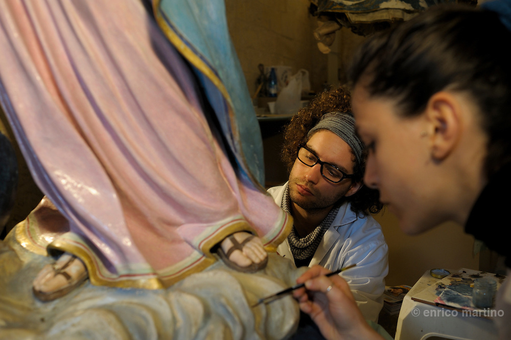 Lecce, Charles V castle. Papier-machè Museum, Rocco Bonomo and Annarita Chiappa are students working in the restauration workshop.