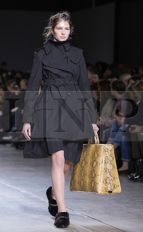 © Licensed to London News Pictures. 18 February 2014, London, England, UK. A model walks the runway at the Simone Rocha show during London Fashion Week AW14 at the Topshop Show Space/Tate Modern. Photo credit: Bettina Strenske/LNP