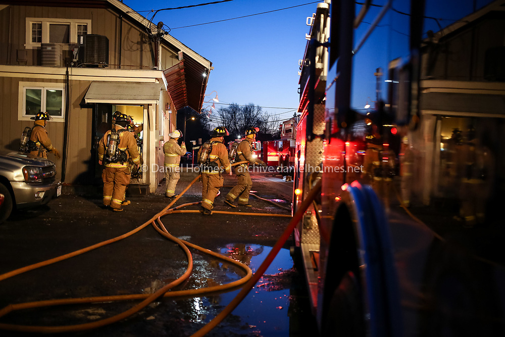 (2/18/16, HOLLISTON, MA) Firefighters investigate a smoke condition around 5:30 p.m. at Casey's Pub in Holliston on Thursday. According fire radio communications, a small fire may have started at an exterior wall from an improperly disposed cigarette. Daily News and Wicked Local Photo/Dan Holmes