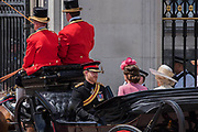"""Kate, Camilla and Harry enter Buckingham Palace - Trooping the Colour by the Irish Guards on the Queen's Birthday Parade. The Queen's Colour is """"Trooped"""" in front of Her Majesty The Queen and all the Royal Colonels.  His Royal Highness The Duke of Cambridge takes the Colonel's Review for the first time on Horse Guards Parade riding his horse Wellesley. The Irish Guards are led out by their famous wolfhound mascot Domhnall and more than one thousand Household Division soldiers perform their ceremonial duty. The Soldiers will parade in the traditional ceremonial uniforms of the Household Cavalry, Royal Horse Artillery, and Foot Guards. They are accompanied by the Household Division Bands & Corps of Drums. London 17th June 2017."""