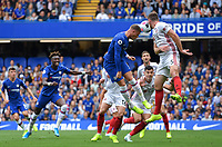 Football - 2019 / 2020 Premier League - Chelsea vs. Sheffield United<br /> <br /> Chelsea's Ross Barkley battles for possession with Sheffield United's Jack O'Connell, at Stamford Bridge.<br /> <br /> COLORSPORT/ASHLEY WESTERN