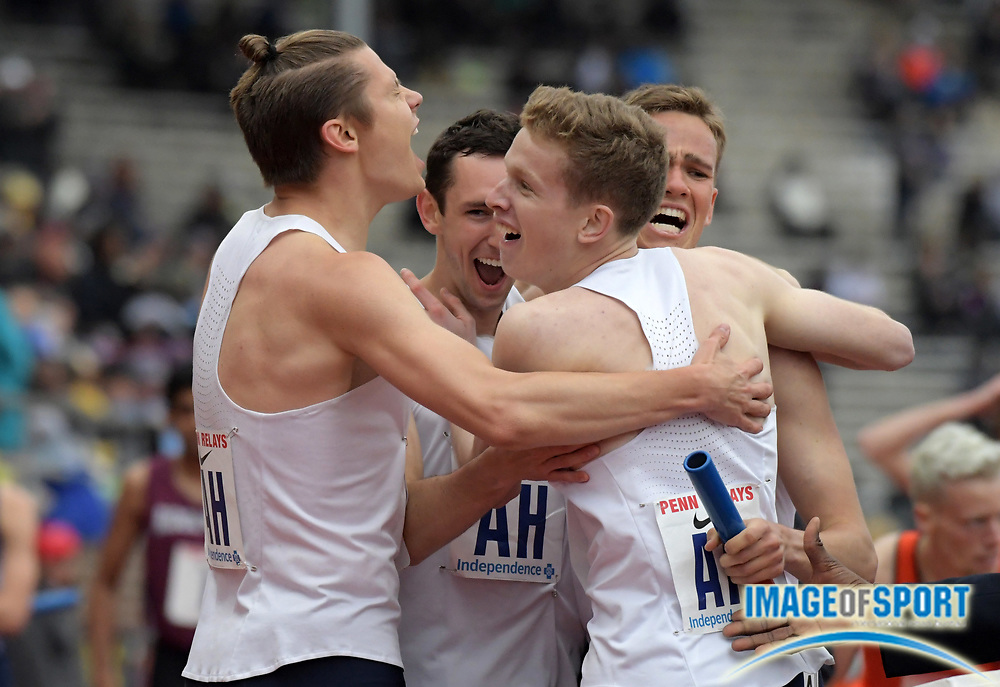 Apr 27, 2018; Philadelphia, PA, USA; Members of the Villanova distance medley relay pose celebrate after winning the Championship of America race in 9:34.97 during the 124th Penn Relays at Franklin Field. From left: Brian Faust, Ben Malone, Ville Lampine and iCasey Comber.