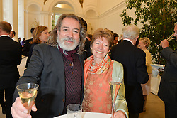 Designer ALEX KRENN and KATHERINE PURCELL at a party to celebrate the 150th anniversary of Wartski held at The Orangery, Kensington Palace, London, on 19th May 2015.