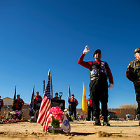 111213    Brian Leddy<br /> Tooley Brown and Lionel Gutierrez speak during the funeral of Harry Botkin Tuesday. The two are part of the Vets Helping Vets organization, which makes sure local veterans receive proper honors during burial.