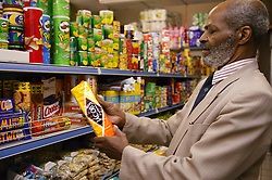 Man at his local shop; East Midlands Supermarket; Nottingham,