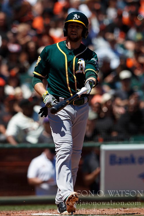 SAN FRANCISCO, CA - JULY 15: Jed Lowrie #8 of the Oakland Athletics tosses his bat after drawing a walk against the San Francisco Giants during the fourth inning at AT&T Park on July 15, 2018 in San Francisco, California. The Oakland Athletics defeated the San Francisco Giants 6-2. (Photo by Jason O. Watson/Getty Images) *** Local Caption *** Jed Lowrie