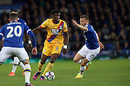 Wilfried Zaha of Crystal Palace looks to go past Tom Cleverley of Everton. Premier league match, Everton v Crystal Palace at Goodison Park in Liverpool, Merseyside on Friday 30th September 2016.<br /> pic by Chris Stading, Andrew Orchard sports photography.