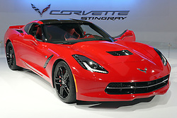 """08  February 2013: 2014 Chevrolet Corvette Stingray sports car. Chicago Auto Show, Chicago Automobile Trade Association (CATA), McCormick Place, Chicago Illinois<br /> <br /> 2014 CHEVROLET CORVETTE STINGRAY: Crowds will be swarming to the Chevrolet exhibit during the ten-day run of the 2013 Chicago Auto Show to be among the first to see the 2014 Corvette on display. Visually stunning, the '14 Corvette's sculptured, aerodynamic two-door hatchback exterior and track-capabilities is worthy of the iconic """"Stingray"""" designation. This marks the seventh-generation of """"America's Sport Car,"""" and as the C7, goes farther than ever, thanks to today's advancements in design, technology and engineering. Matching the dramatic exterior is a new 6.2 liter (376 cubic inch) LT1 V-8 engine that pumps out 450 horsepower and 450 lb.-ft. of torque to the rear wheels. Consumers have their choice of a six-speed paddle-shift automatic or seven-speed manual gearbox with """"Active Rev Match"""" that anticipates gear selections and matches engine speed for perfect shifts every time. Either way, we're talking 0-to-60 mph in less than four seconds. For 2014, the latest Corvette shares only two parts with the previous generation model. Underneath is an all-new frame structure and chassis that helped shift weight rearward for an optimal 50/50 weight balance. Lightweight features include a carbon fiber hood and removable roof panel; composite fenders, doors and rear quarter panels. Slide into the cockpit composed of premium materials, smaller-diameter steering wheel, standard dual, eight-inch configurable driver/infotainment screens and available color head-up display. There are two new seat choices - each featuring a lightweight magnesium frame. You can see the 2014 Corvette Stingray coupe in Chicago from Feb. 9th-18th, or wait until they roll into Chevrolet dealerships the third quarter of 2013."""