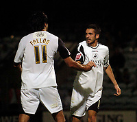 Photo: Jed Wee.<br /> Scunthorpe United v Swansea City. Coca Cola League 1. 08/08/2006.<br /> <br /> Swansea's Tom Williams (R) celebrates after setting up Rory Fallon for his goal.