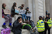 City Police officers chat to environmental activists protest about Climate Change during the blockade outside the Bank of England in the heart of the capitals financial district, the City of London aka the Square Mile, on the seventh day of a two-week prolonged worldwide protest by members of Extinction Rebellion, on 14th October 2019, in London, England.