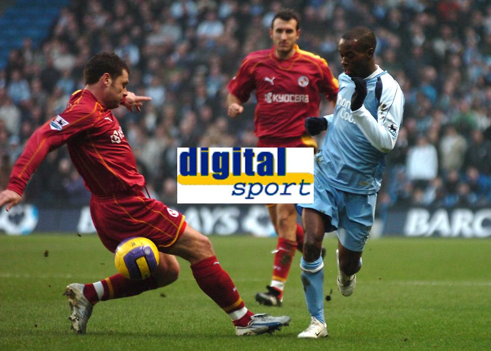 Photo: Paul Greenwood.<br />Man City v Reading. The Barclays Premiership. 03/02/2007. Man City's Damarcas Beasley goes around Nicky Shorey