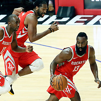 28 February 2018: Houston Rockets guard James Harden (13) brings the ball up court next to Houston Rockets forward Luc Mbah a Moute (12) and Houston Rockets center Nene Hilario (42) during the Houston Rockets 105-92 victory over the LA Clippers, at the Staples Center, Los Angeles, California, USA.