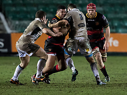 Dragons' Leon Brown under pressure from Glasgow Warriors' Siua Halanukonuka<br /> <br /> Photographer Simon King/Replay Images<br /> <br /> Guinness PRO14 Round 14 - Dragons v Glasgow Warriors - Friday 9th February 2018 - Rodney Parade - Newport<br /> <br /> World Copyright © Replay Images . All rights reserved. info@replayimages.co.uk - http://replayimages.co.uk