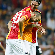 Galatasaray's celebrates his goal Sercan Yildirim, Albert Riera Ortega (L-R) during their Turkish Super League soccer match Galatasaray between Akhisar Belediyespor at the TT Arena at Seyrantepe in Istanbul Turkey on Sunday 23 September 2012. Photo by TURKPIX