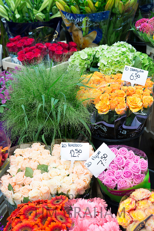 Bunch of bright colour flowers - roses, gerbera, at famous flower market, Bloemenmarkt in Amsterdam, Holland