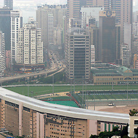 Asia, China, Hong Kong. Racetrack and Skyscrapers.