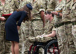 © licensed to London News Pictures. 25/06/2011. Windsor ,UK.  Kate Middleton talks to Lance Corporal Yarrington. Prince WIlliam and Kate Middleton at Victoria Barracks, Windsor, Berks on Armed Forces day today (25/06/2011) for a Welcome home parade for the Irish Guards following their tour of duty in Helmand province, Afghanistan. See special instructions. Mandatory photo credit: Matt Cetti-Roberts/LNP