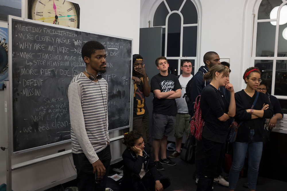 Students listen to Associate Dean of the Yale School of Art, Sam Messer (not pictured) inside the office of Cooper Union's president, Jamshed Bharucha in New York, NY, on Thursday, May 9, 2013. Over 50 students began a sit-in Wednesday inside the office of the school's president, Jamshed Bharucha, calling for his resignation...Photograph by Andrew Hinderaker.